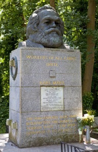 Tomb and Statue of Philosopher Karl Marx, marking his resting place in Highgate Cemetery, London.